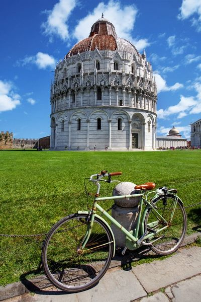 View of Pisa Baptistry With a Bicycle in the Foreground At Piazza dei Miracoli (Piazza del Duomo), Pisa, Tuscany, Italy