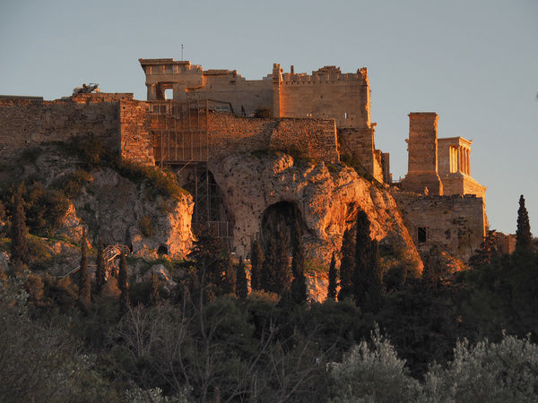 View of the Acropolis of Athens seen from the Plaka district in the golden light of the sunset