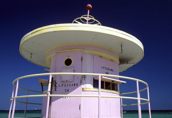 Pink Art deco lifeguard station, with a sign 'Lifeguard on Duty', Miami, South Beach, Florida, USA