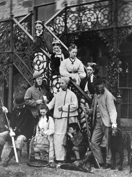 1864: A family group gathered on an outside staircase with a parrot in a cage. They also have a gun-dog and some dead pheasants, one of them is cleaning his gun. (Photo by Hulton Archive/Getty Images)