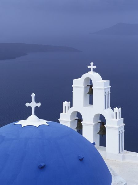 Dome and belfry of a Greek Orthodox church. Fira, Santorini, Cyclades Islands, Greece