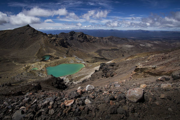 One of the Emerald Lakes between Mounts Ngauruhoe and Raupehu seen from Red Crater on the Tongariro Alpine Crossing, a 19.4 km one-way trek from Mangatepopo to Ketetahi over volcanic terrain. Tongariro National Park, Manawatu-Wanganui, North Island