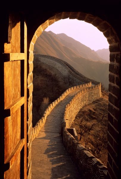 Great Wall of China view from inside one of the 1200 watch towers and blockhouses, at sunset. Near Beijing, China