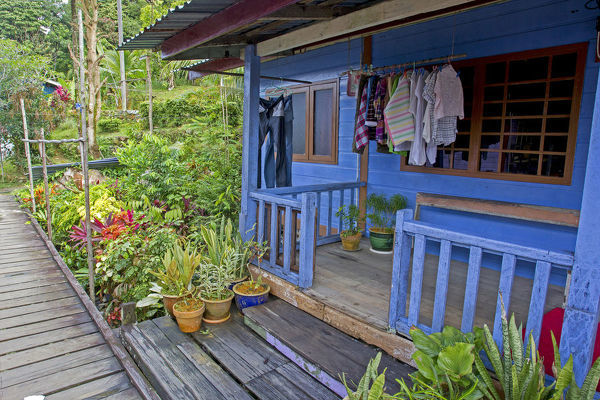 House with bright blue-painted deck in a fishing village on Salak Island in the Salak River estuary, near Kuching, Sarawak, Borneo, Malaysia