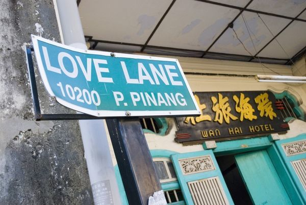 Love Lane street sign outside the Hotel Wan Hai (roughly translated as 'chasing pussy'). George Town, Penang Island, Malaysia