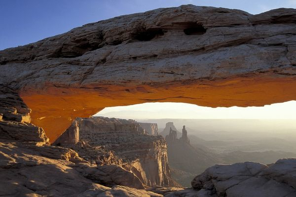 Mesa Arch at sunrise, a pothole arch of Entrada sandstone, Island in the Sky area