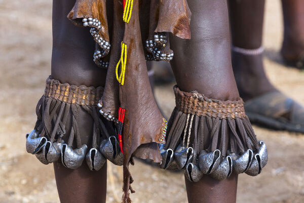 Metal adornments dangling from leg ornaments of a Hamer young woman. Omo Valley, southwestern Ethiopia