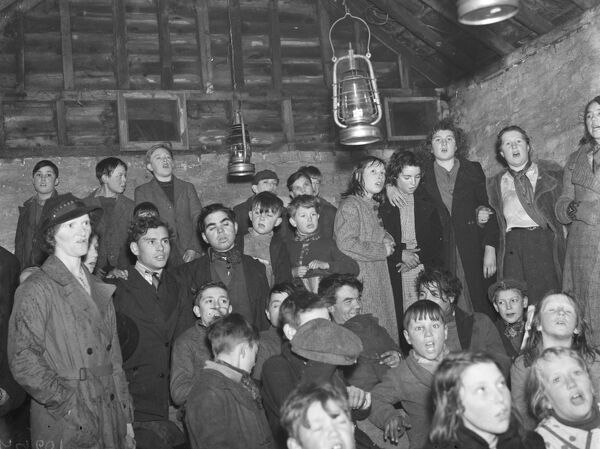 Gypsy children 's Sunday school in the cow shed in St Mary Cray ) .  Mrs Ruttley with the children .  1939 Travellers Romany Gypsy Gipsy gypsies Roma. social history