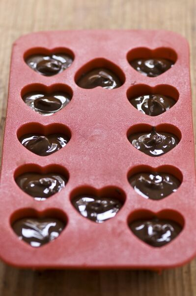 Making Heart Shaped In Chocolates For Valentines Day In Red Heart