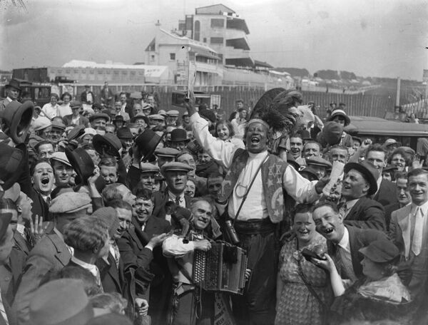 Prince Monolili gets in trim for Derby day .  Gypsies, tipsters, including Prince Monolul, hawkers and the hundred and one others who lend colour to Derby Day, together with large numbers of sightseers making the customary inspection of the course