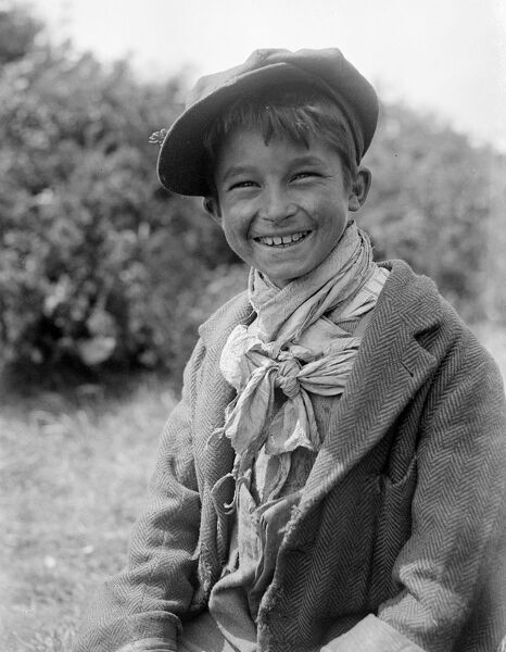 A Romany gypsy boy at the Epsom race meeting .   Late 1940's, early 1950's