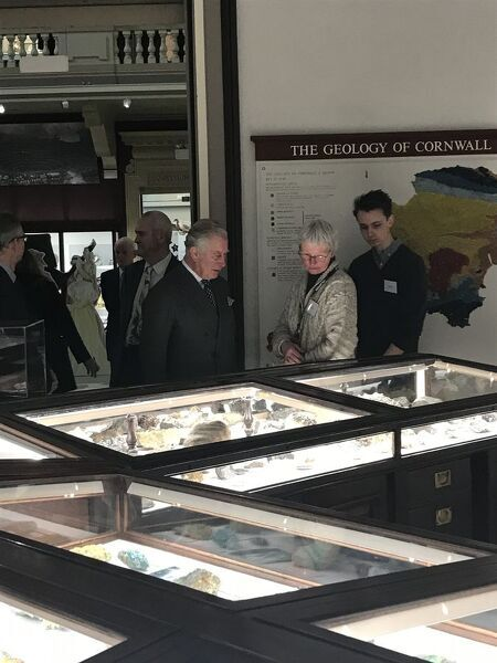 The Duke of Cornwall talks to the museum's Volunteer Geological Curatorial Assistant about some of the important Cornish minerals on display in the Rashleigh Gallery. Another one of the museum's volunteers looks on. The Director of the Royal Cornwall Museum