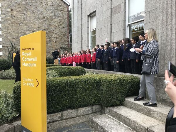 "A choir of students from local primary schools sing a special composition ""This is Cornwall"" upon the arrival of the Duke of Cornwall at the museum. One of a series of images documenting the visit of the Royal Institution of Cornwall's patron"