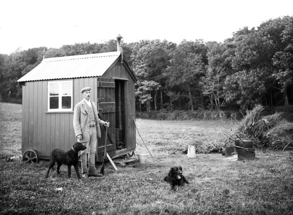 Gamekeeper with his dogs and mobile hut. Early 1900s