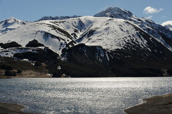 This photo taken on September 26, 2011shows a lake and snow capped mountains near Hanmer Springs on New Zealand's South Island. Hanmer Springs is New Zealand's Alpine Spa Village, renowned for its forest and snow covered mountains, alpine rivers
