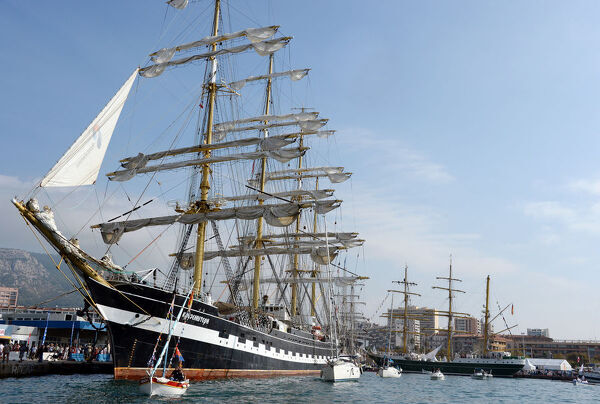 "This picture taken on September 27, 2013 shows the ""Krusenstern"", a Russian four masted schoolship, (L) as it is moored in the harbour of Toulon, southern France, where tall ships are moored for four days as part of the Mediterranean"