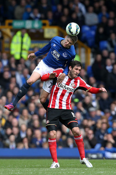 Everton's John Stones (left) and Sunderland's Danny Graham battle for a ball in the air during the Barclays Premier League match at Goodison Park, Liverpool. PRESS ASSOCIATION Photo. Picture date: Saturday May 9, 2015. See PA story SOCCER Everton