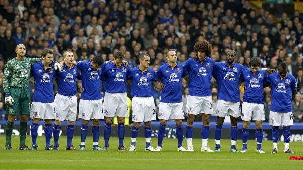 The Everton players stand for a minuite's silence before kick off
