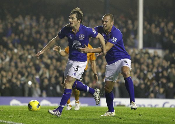 Everton's Leighton Baines (left) celebrates with his team mate Johnny Heitinga (right) after he scores their side's second goal of the game from the penalty spot