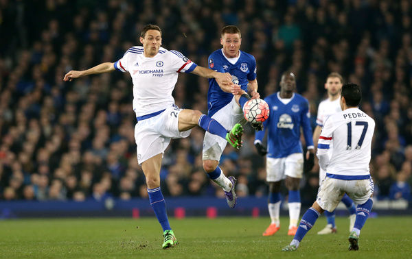 Everton's James McCarthy (right) and Chelsea's Nemanja Matic battle for the ball during the Emirates FA Cup, Quarter Final match at Goodison Park, Liverpool