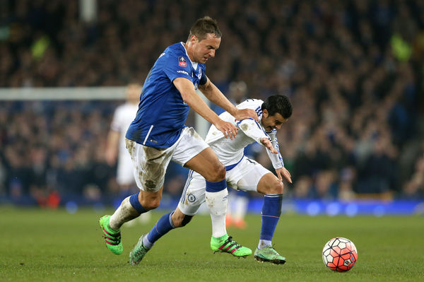 Everton's Phil Jagielka (left) and Chelsea's Pedro battle for the ball during the Emirates FA Cup, Quarter Final match at Goodison Park, Liverpool