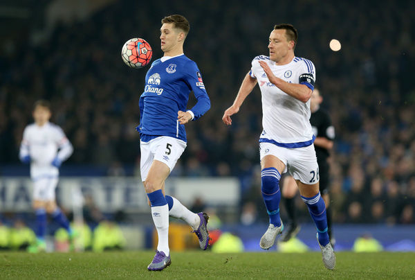 Chelsea's John Terry (right) and Everton's John Stones battle for the ball during the Emirates FA Cup, Quarter Final match at Goodison Park, Liverpool