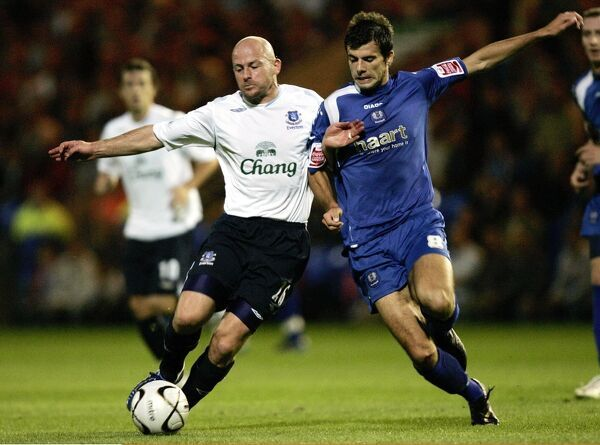 Everton's Lee Carsley and Peterbrough's Richard Butcher in action