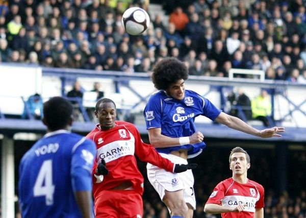 Football - Everton v Middlesbrough - FA Cup Quarter Final - Goodison Park - 08/09 - 8/3/09 Everton's Marouane Fellaini (R) in action against Middlesbrough's Justin Hoyte Mandatory Credit: Action Images / Keith Williams
