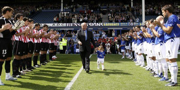 Howard Kendall walks out with his grand daughter before the match Mandatory Credit: Action Images / Carl Recine Livepic