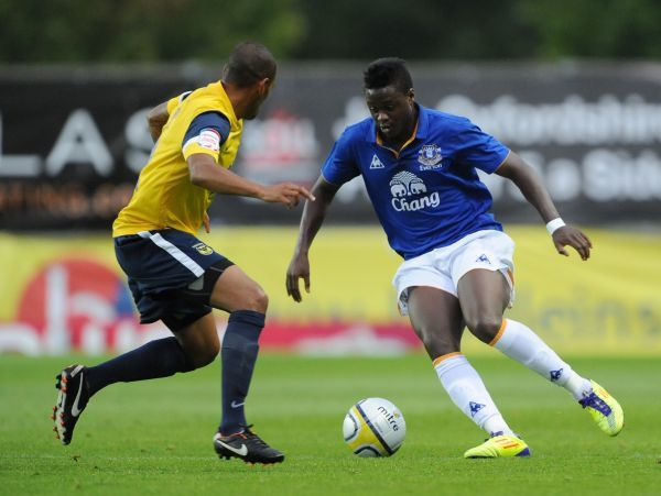 Oxford United's Damian Batt and Everton's Magaye Gueye (right)