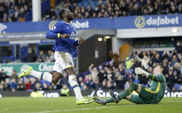 Everton's Romelu Lukaku (centre) scores his side's third goal of the game during the Premier League match at Goodison Park, Liverpool