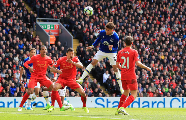 Everton's Mason Holgate directs a header on goal during the Premier League match at Anfield, Liverpool