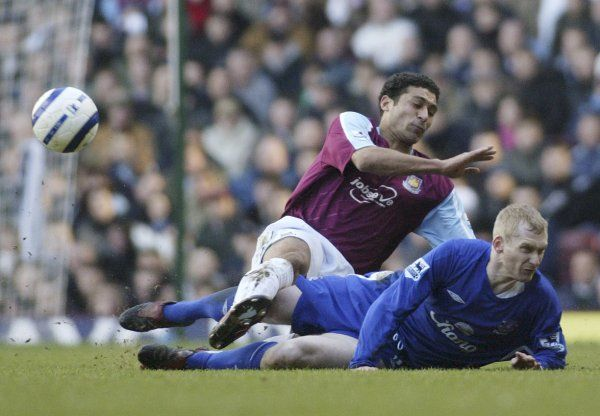Tony Hibbert tussles with Hayden Mullins Mandatory Credit: Action Images / Lee Mills Livepic