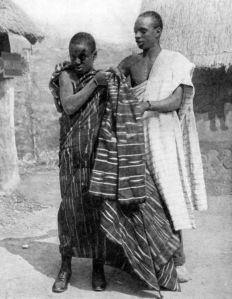 A man and a boy from the Ashanti people, Ghana, Africa, 1936. From Peoples of the World in Pictures, edited by Harold Wheeler, published by Odhams Press Ltd (London, 1936)
