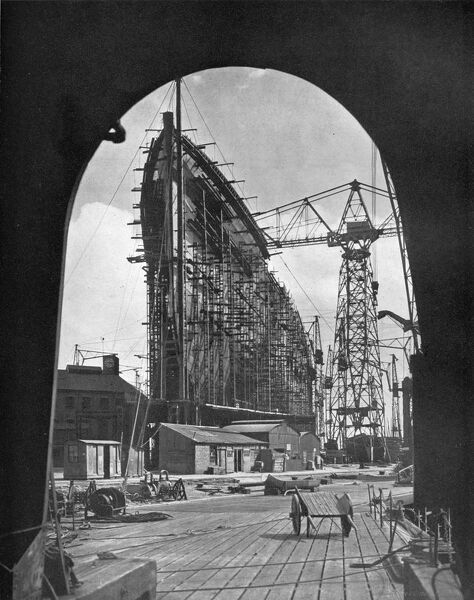 'A striking bow view of the giant Cunard liner, Queen Mary, under construction at Clydebank, Glasgow', 1934. Queen Mary was the flagship of the Cunard Line from May 1936 until October 1946 when she was replaced in that role by Queen Elizabeth