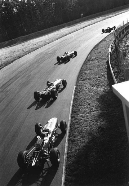 2003 Racing Past... Exhibition 1965 Italian Grand Prix, Monza. Jim Clark, Jackie Stewart, Graham Hill and Dan Gurney drift through the Parabollica. World Copyright - LAT Photographic Exhibition ref: a103