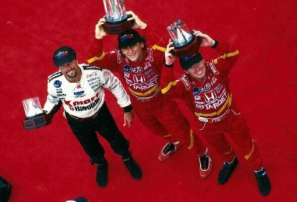 Alex Zanardi (ITA) celebrates victory on the podium. The other podium finishers are Michael Andretti (USA) left, and Jimmy Vasser (USA) right. CART Fedex World Series, Toronto, Canada. 19 July 1998