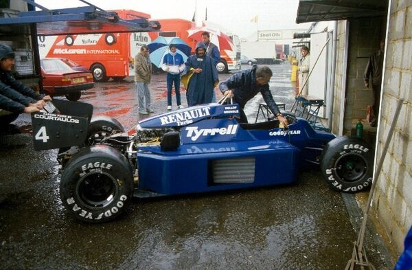 A Tyrrell 014 is pushed into the pit garage. British Grand Prix, Silverstone, England, July 1985
