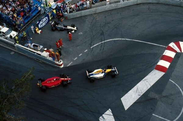 Nigel Mansell (GBR) Williams Renault FW14 followed by the Ferrari of Alain Prost (FRA) with the retired Tyrrell of Satoru Nakajima (JPN). Monaco GP, Monte Carlo, Monaco, 12 May 1991