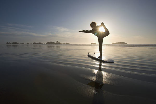 Silhouette Of Female Surfer Doing Bow Pulling Yoga Pose ...
