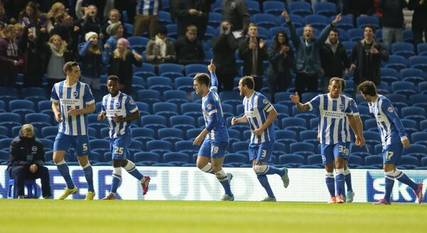 Gary Gardner scores a goal during the Sky Bet Championship match between Brighton and Hove Albion and Wigan Athletic at the American Express Community Stadium, Brighton and Hove, England on 4 November 2014