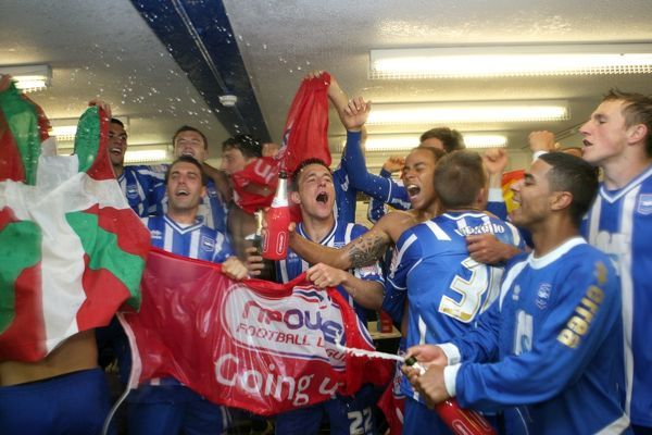 The players celebrate promotion to The Championship in 2011