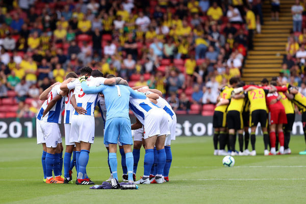 The team huddle before kick-off. Match action during the Premier League match between Watford and Brighton and Hove Albion at Vicarage Road, Watford on the 11th August 2018