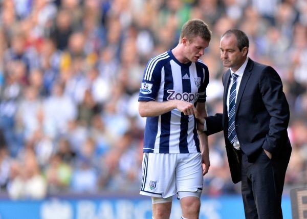 Chris Brunt of West Bromwich Albion gets some instructions from Steve Clarke head coach / manager of West Bromwich Albion