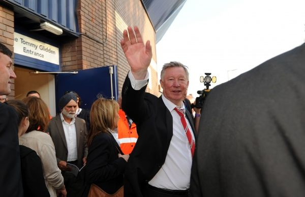 Sir Alex Ferguson the head coach / manager of Manchester United waves as he leaves after his 1500th and final match, at The Hawthorns the home stadium of West Bromwich Albion