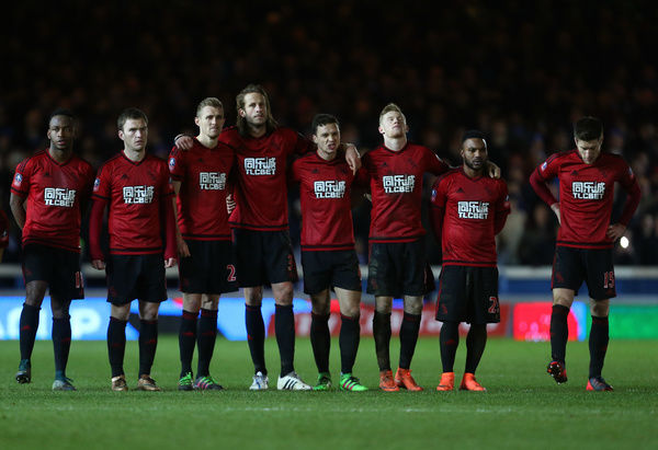 The West Bromwich Albion team watch the penalty shootout