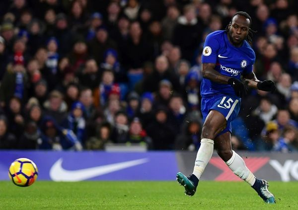 LONDON, ENGLAND - FEBRUARY 12: Victor Moses of Chelsea scores his sides second goal during the Premier League match between Chelsea and West Bromwich Albion at Stamford Bridge on February 12, 2018 in London, England
