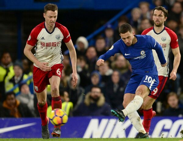 LONDON, ENGLAND - FEBRUARY 12: Eden Hazard of Chelsea scores the 3rd Chelsea goal during the Premier League match between Chelsea and West Bromwich Albion at Stamford Bridge on February 12, 2018 in London, England