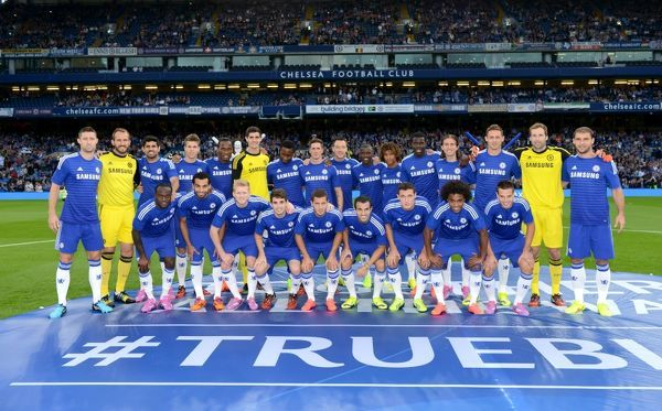 Chelsea players pose for a group photo after they are presented to the fans before the match ahead of the new season