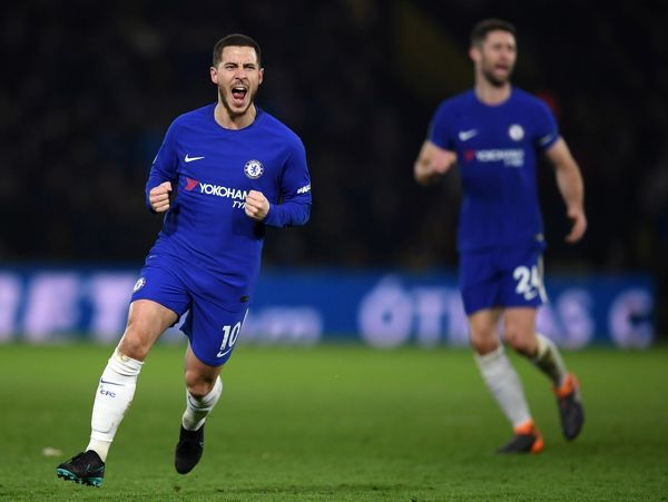 WATFORD, ENGLAND - FEBRUARY 05: Eden Hazard of Chelsea celebrates scoring the first Chelsea goal during the Premier League match between Watford and Chelsea at Vicarage Road on February 5, 2018 in Watford, England